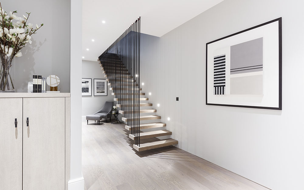 A colour CGI image of a modern wooden staircase at The Arts House renovation - 108-110 Gloucester Road, London - a Henley Space residential development