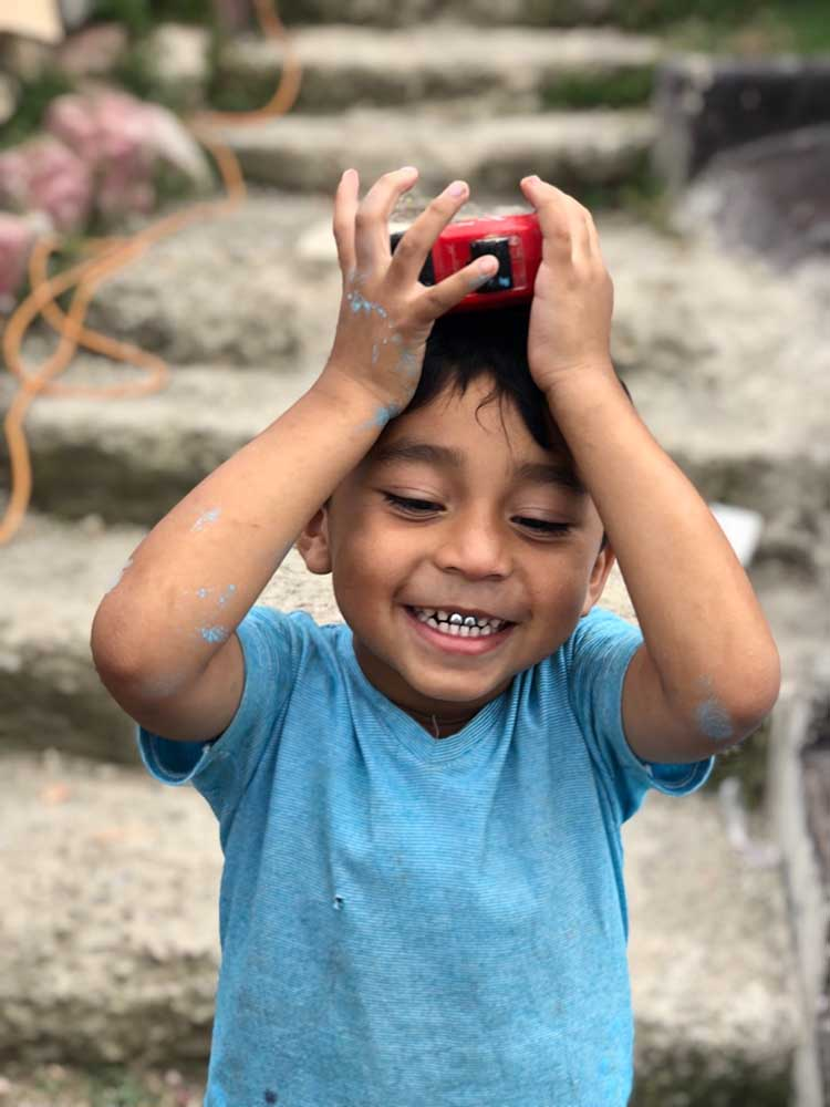 Henley Investments - Homes for Hope smiling boy in Costa Rica